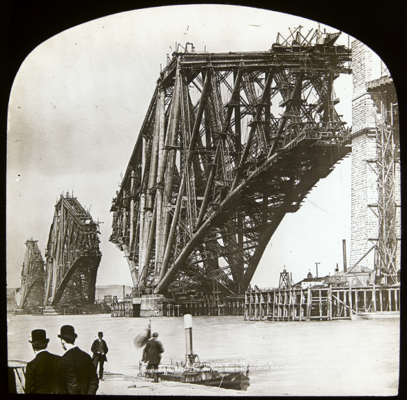 View from South Queensferry of the construction of the Forth Rail Bridge