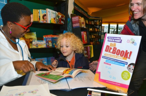 Tomi, dr book sign & child