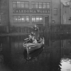 Home Guard 1940 Home Guards patrol a section of canal in Edinburgh in a motor boat armed with rifles and a mounted Lewis gun, 19 October 1940.