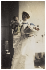 Mary Cunningham, nurse, holding two babies at Edinburgh Royal Maternity Hospital