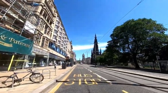 A view of Princes Street on a sunny day but deserted of people and traffic.